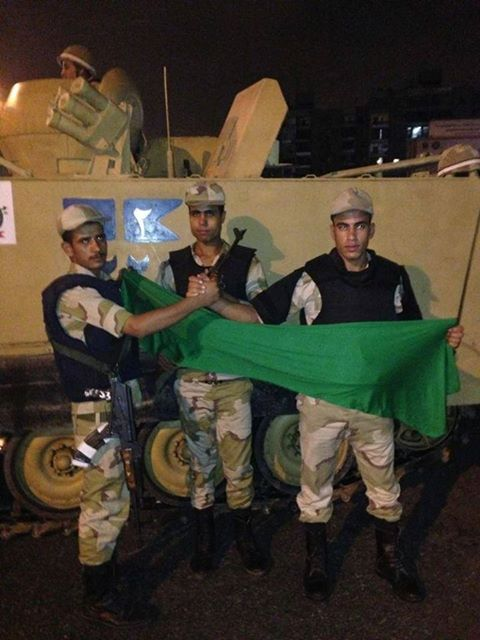 Egyptian Army Hold the Green Flag of Free Libya in support of all Libyans